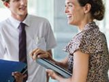 lady with bad hair talks to man with awkward tie about the long hiring process