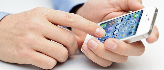 A man looking for the best apps for business on his mobile phone