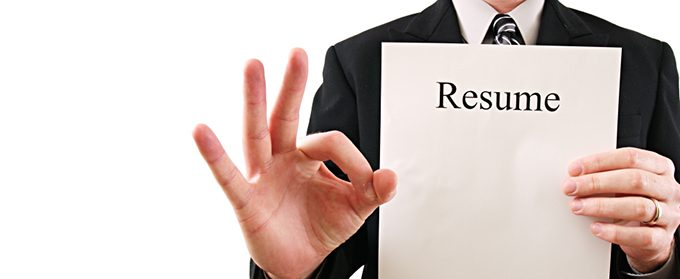 business man holding a resume with okay sign